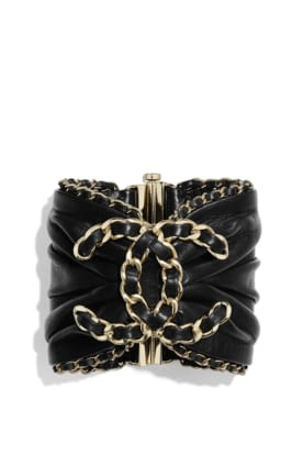AB2574-Y47891-Z9195 Bracelet in golden metal and black leather.jpg